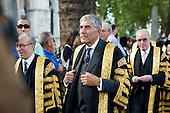 Lord Phillips, President of The Supreme Court, and Deputy President Lord Hope lead the new Justices from the court to Westminster Abbey.