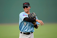 Third baseman Dustin Harris (9) of the Hickory Crawdads in a game against the Greenville Drive on Thursday, August 26, 2021, at Fluor Field at the West End in Greenville, South Carolina. (Tom Priddy/Four Seam Images)