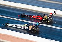 Nov 1, 2020; Las Vegas, Nevada, USA; NHRA top fuel driver Steve Torrence (far) defeats Justin Ashley during the NHRA Finals at The Strip at Las Vegas Motor Speedway. Mandatory Credit: Mark J. Rebilas-USA TODAY Sports