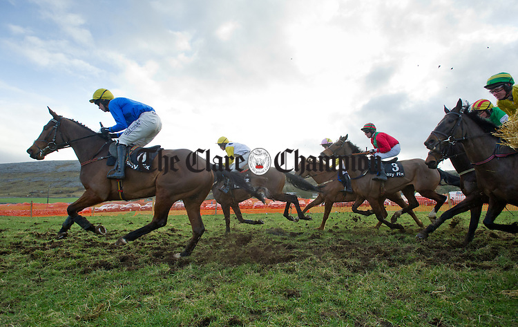 Horses and jockeys race past the first bend at the County Clare Hunt Point To Point in Bellharbour. Photograph by John Kelly.