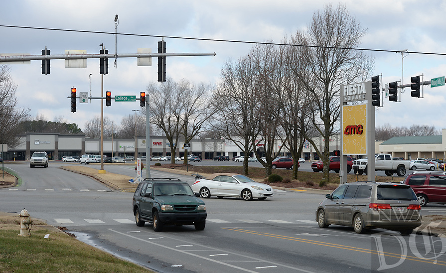 Traffic flows Friday, Jan. 8, 2021, through the intersection of Rolling Hills Drive and College Avenue in Fayetteville. The city has conceptual designs that place a roundabout in the parking lot of the shopping center, connecting Rolling Hills Drive, Appleby Road and Plainview Avenue. Visit nwaonline.com/210110Daily/ for today's photo gallery. <br /> (NWA Democrat-Gazette/Andy Shupe)