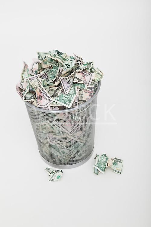 USA, Illinois, Metamora, Pile of money in trashcan