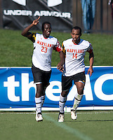 Schillo Tshuma (23) of Maryland celebrates his goal with teammate Jordan Cyrus (14) during the game at the Maryland SoccerPlex in Germantown, MD. Maryland defeated North Carolina, 2-1,  to win the ACC men's soccer tournament.