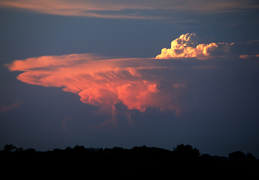 "A distant view of a supercell thunderstorm (cumulonimbus)cloud with a large ""overshooting top"" near Abilene Kansas. Large ""overshooting tops"" are usually indicative of severe weather. This storm produced baseball size hail and several tornadoes."