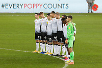 Swansea players observe a minute's silence prior to the Sky Bet Championship between Swansea City and Rotherham at the Liberty Stadium, Swansea, Wales, UK. Saturday 21 November 2020