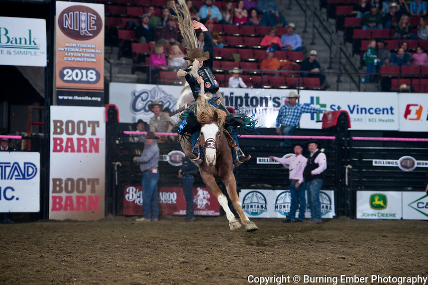Zeke Thurston on Powder River Rodeos Morning Tea with the high marked ride of the night with at 86 in the Saddle Bronce event at the NILE PRCA 2nd perf Event. October 19th, 2018.  Photo by Josh Homer/Burning Ember Photography.  Photo credit must be given on all uses.