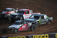 Dec. 11, 2011; Chandler, AZ, USA;  LOORRS pro buggy driver Cameron Steele (17) leads Casey Currie and Rodrigo Ampudia during the Lucas Oil Challenge Cup at Firebird International Raceway. Mandatory Credit: Mark J. Rebilas-