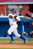 Victor Soto #35 of the Burlington Royals follows through on his swing versus the Elizabethton Twins at Burlington Athletic Park July 19, 2009 in Burlington, North Carolina. (Photo by Brian Westerholt / Four Seam Images)