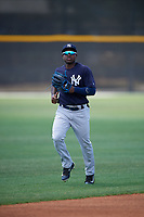 New York Yankees center fielder Tito Polo (4) jogs back to the dugout during a minor league Spring Training game against the Toronto Blue Jays on March 30, 2017 at the Englebert Complex in Dunedin, Florida.  (Mike Janes/Four Seam Images)