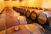 The barrel cellar for aging the wines in oak casks - Chateau La Grave Figeac, Saint Emilion, Bordeaux