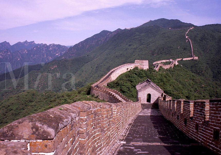 Chinese landscape with a section of the Great Wall as it extends into the mountain background. Mutianyu, China.