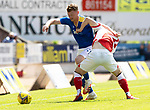 St Johnstone v Fleetwood Town…24.07.21  McDiarmid Park<br />James Brown battles with Max Clark<br />Picture by Graeme Hart.<br />Copyright Perthshire Picture Agency<br />Tel: 01738 623350  Mobile: 07990 594431