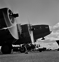 Two of the four mighty engines of a new B-17F (Flying Fortress) bombers warm up at the airfield of Boeing's Seattle plant, 1942.<br /> <br /> Photo by Andreas Feininger.
