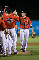 Alex Call (2) of the Kannapolis Intimidators high fives his teammates following their win over the West Virginia Power at Kannapolis Intimidators Stadium on August 20, 2016 in Kannapolis, North Carolina.  The Intimidators defeated the Power 4-0.  (Brian Westerholt/Four Seam Images)