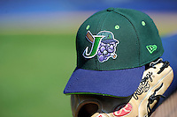 Jamestown Jammers hat and glove on the post before a game against the Williamsport Crosscutters on June 20, 2013 at Russell Diethrick Park in Jamestown, New York.  Jamestown defeated Williamsport 12-6.  (Mike Janes/Four Seam Images)
