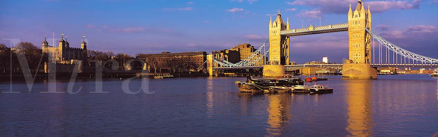 © David Paterson.The Tower of London (left) and Tower Bridge in evening light, London...Keywords: London, river, Thames, Tower, bridge, boats, evening, city, landmark, capital, history, calm, serene, warm