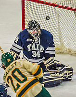 4 January 2014:  Yale University Bulldog goaltender Alex Lyon, a Freshman from Baudette, MN, has a shot sail over the open net during the third period against the University of Vermont Catamounts at Gutterson Fieldhouse in Burlington, Vermont. With an empty net and seconds remaining, the Cats came back to tie the game 3-3 against the 10th seeded Bulldogs. Mandatory Credit: Ed Wolfstein Photo *** RAW (NEF) Image File Available ***