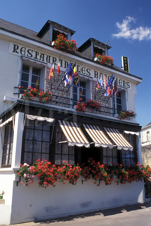 Loire Valley, Amboise, France, Loire Castle Region, Indre-et-Loire, Europe, Restaurant decorated with flowers and flags in the city of Amboise.