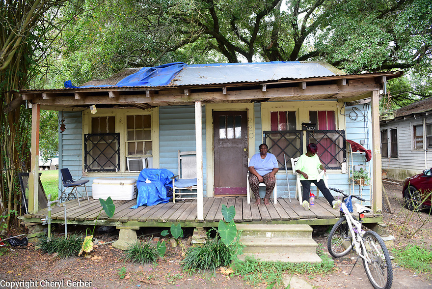 Mable Johnson and Brenda Gaile Francisco Lee sit on their porch in Marksville, La., Sept. 17, 2017.