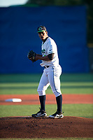Hillsboro Hops starting pitcher Luis Frias (19) gets ready to deliver a pitch during a Northwest League game against the Salem-Keizer Volcanoes at Ron Tonkin Field on September 1, 2018 in Hillsboro, Oregon. The Salem-Keizer Volcanoes defeated the Hillsboro Hops by a score of 3-1. (Zachary Lucy/Four Seam Images)