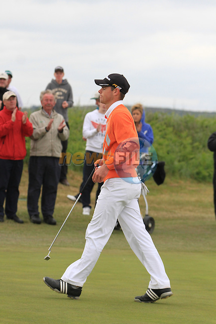 Richard O'Donovan as he finished putting for a 66 on the second round of the final day at the East of Ireland Amateur Open Championship 2011 in Co.Louth Golf Club...(Photo credit should read Jenny Matthews www.newsfile.ie)....This Picture has been sent you under the conditions enclosed by:.Newsfile Ltd..The Studio,.Millmount Abbey,.Drogheda,.Co Meath..Ireland..Tel: +353(0)41-9871240.Fax: +353(0)41-9871260.GSM: +353(0)86-2500958.email: pictures@newsfile.ie.www.newsfile.ie.