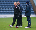Hamilton manager Alex Neil inspects the Dens Park pitch before the game was called off by Referee Craig Thomson.