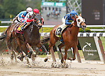 June 8, 2013. #12 Ah Gaga, Mike Smith up, wins the third race on Belmont Stakes day, a seven-furlong maiden race taken off the turf, for fillies and mares 3 and upward foaled in NY State. #14 Concealed (left),Junior Alvarado up, was second. Belmont Park, Elmont, New York (Joan Fairman Kanes/Eclipse Sportswire)