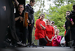 Dancers look on from the wings as they wait to perform at the official opening of the All-Ireland Fleadh 2017 in Ennis. Photograph by John Kelly.