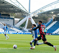 13th April 2021; The John Smiths Stadium, Huddersfield, Yorkshire, England; English Football League Championship Football, Huddersfield Town versus Bournemouth; Duane Holmes of Huddersfield Town defending against Arnaut Danjuma of Bournemouth Strictly Editorial Use Only. No use with unauthorized audio, video, data, fixture lists, club/league logos or 'live' services. Online in-match use limited to 120 images, no video emulation. No use in betting, games or single club/league/player publications