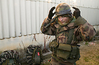Member of the French Foreign Legion Maxim Sharapov removes his helmet during a full scale multi-force exercise held at the airport of Tarbes, France, 12 December 2007.