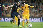 FC Barcelona's Leo Messi (r) and  Atletico de Madrid's Diego Godin during Champions League 2015/2016 match. April 5,2016. (ALTERPHOTOS/Acero)