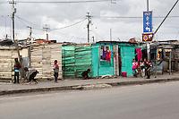 South Africa, Cape Town, Guguletu Township Roadside Scene.  Children and Houses.