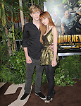 Bella Thorne and boyfriend at Warner Bros. L.A. Premiere of JOURNEY 2 The Mysterious Island held at The Grauman's Chinese Theatre in Hollywood, California on February 02,2012                                                                               © 2012 Hollywood Press Agency