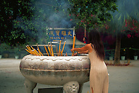 Incense offering to Buddha at thr Po Lin Monastery, Lantan, China
