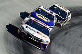 BRISTOL, TENNESSEE - MAY 31: Denny Hamlin, driver of the #11 FedEx Express Toyota, leads Chase Elliott, driver of the #9 NAPA Auto Parts Chevrolet, and Aric Almirola, driver of the #10 Smithfield Ford, during the NASCAR Cup Series Food City presents the Supermarket Heroes 500 at Bristol Motor Speedway on May 31, 2020 in Bristol, Tennessee. (Photo by Jared C. Tilton/Getty Images)