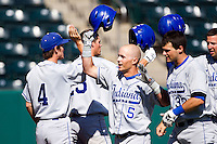Koby Kraemer (5) of the Indiana State Sycamores is congratulated by teammates after hitting a home run during a game against the Evansville Purple Aces in the 2012 Missouri Valley Conference Championship Tournament at Hammons Field on May 23, 2012 in Springfield, Missouri. (David Welker/Four Seam Images)