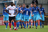 Billy Healey of Wingate & Finchley scores the third goal for his team and celebrates with his team mates during Wingate & Finchley vs Lewes, Pitching In Isthmian League Premier Division Football at the Maurice Rebak Stadium on 3rd October 2020