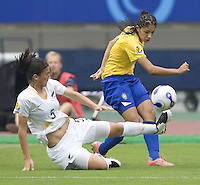 New Zealand defender (5) Abby Erceg and Brazil forward (11) Cristiane. Brazil (BRA) defeated New Zealand (NZL) 5-0 in their  FIFA Women's World Cup China 2007 Group D opening round match at Wuhan Sports Center Stadium in Wuhan, China on September 12, 2007.