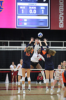 Arkansas Graduate Abigail Archibong (9) spikes ball against Val Green (16) and Elif Yavuz (19) of Auburn on Sunday, Oct. 10, 2021, during play at Barnhill Arena, Fayetteville. Visit nwaonline.com/211011Daily/ for today's photo gallery.<br /> (Special to the NWA Democrat-Gazette/David Beach)
