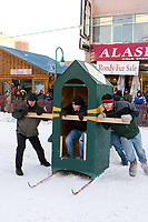 Contestants compete in the Outhouse Race during the Fur Rondy Festival, downtown Anchorage.