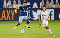 CARSON, CA - OCTOBER 18: Lucas Cavallini #9 of the Vancouver Whitecaps traps a ball in the air during a game between Vancouver Whitecaps and Los Angeles Galaxy at Dignity Heath Sports Park on October 18, 2020 in Carson, California.