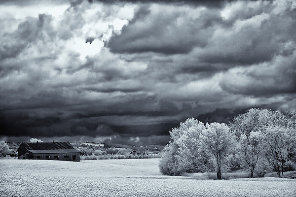 Black and white of barn on stormy day in Oregon