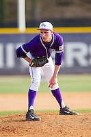 High Point Panthers relief pitcher Jeremy Johnson (14) looks to his catcher for the sign against the Coastal Carolina Chanticleers at Willard Stadium on March 15, 2014 in High Point, North Carolina.  The Chanticleers defeated the Panthers 1-0 in the first game of a double-header.  (Brian Westerholt/Four Seam Images)