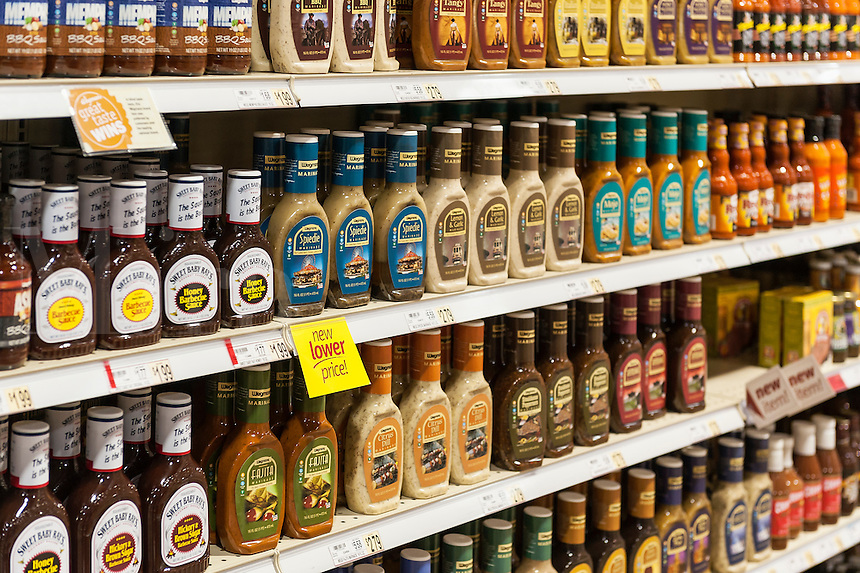 Selection of marinades and barbecue sauce in a grocery store, USA