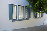 Windows with Blue Shutters