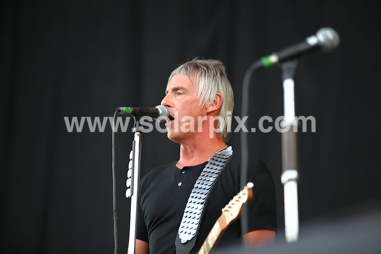 **ALL ROUND PICTURES FROM SOLARPIX.COM**.**WORLDWIDE SYNDICATION RIGHTS**.Paul Weller performing at the V Festival at Weston Park, UK, Sunday August 22nd 2010.This pic: Paul Weller..JOB REF: 11977      NYA     DATE: 22_08_210.**MUST CREDIT SOLARPIX.COM OR DOUBLE FEE WILL BE CHARGED**.**MUST NOTIFY SOLARPIX OF ONLINE USAGE**.**CALL US ON: +34 952 811 768 or LOW RATE FROM UK 0844 617 7637**