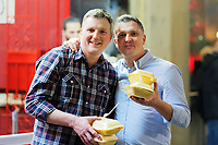 Two men with their take away food in Wind Street, Swansea, Wales  on Mad Friday, Booze Black Friday or Black Eye Friday, the last Friday night before Christmas Day, when traditionally people in the UK go out to celebrate the start of their holidays. Friday 22 December 2017