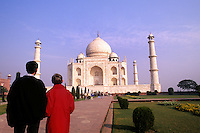 Tourists in colorful dress at the beautiful Taj Mahal monument world famous tomb in Agra India considered the most beautiful building in the world