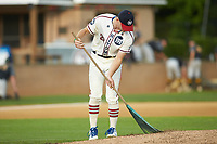 High Point-Thomasville HiToms pitcher Will Lancaster rakes the mound prior to the game against the Wilson Tobs at Finch Field on July 17, 2020 in Thomasville, NC. The Tobs defeated the HiToms 2-1. (Brian Westerholt/Four Seam Images)