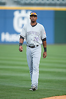 Yorman Rodriguez (20) of the Louisville Bats warms up in the outfield prior to the game against the Charlotte Knights at BB&T BallPark on May 12, 2015 in Charlotte, North Carolina.  The Knights defeated the Bats 4-0.  (Brian Westerholt/Four Seam Images)